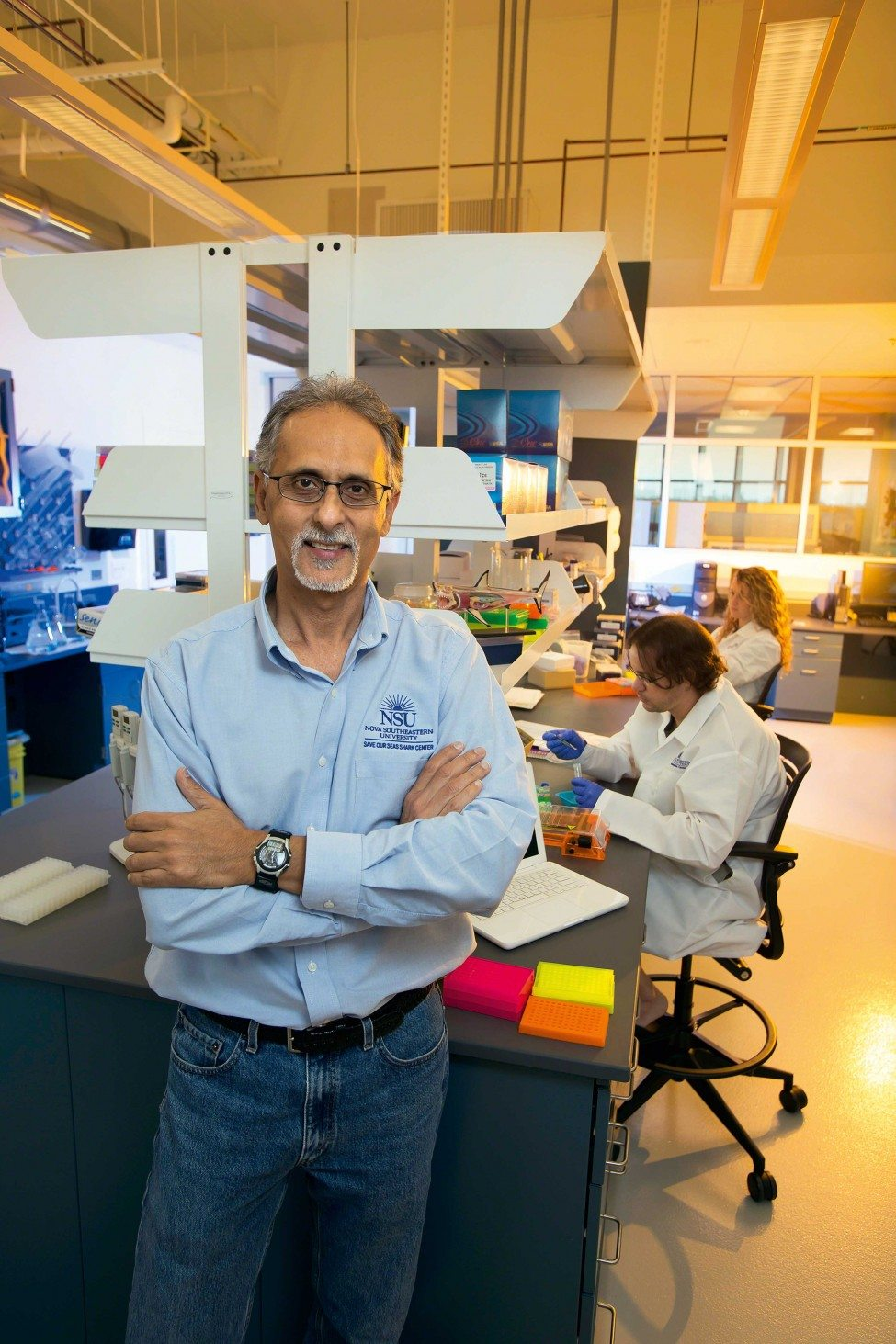 Professor Mahmood Shivji and other researchers working at the SOSSRC laboratory break down the genetic blueprint that makes a shark a shark.<br /> Photo by Nova Southeastern University