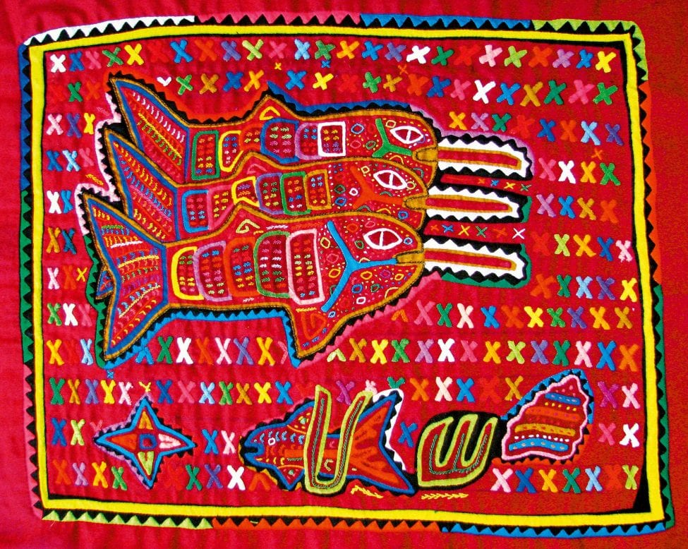 A colourful mola depicting three sawfishes. Molas are hand-made appliqué textiles produced mostly by the Guna women of the San Blas Archipelago, Panama, and often incorporate designs relating to their natural and mythological landscapes.<br /> Photo by Matthew McDavitt