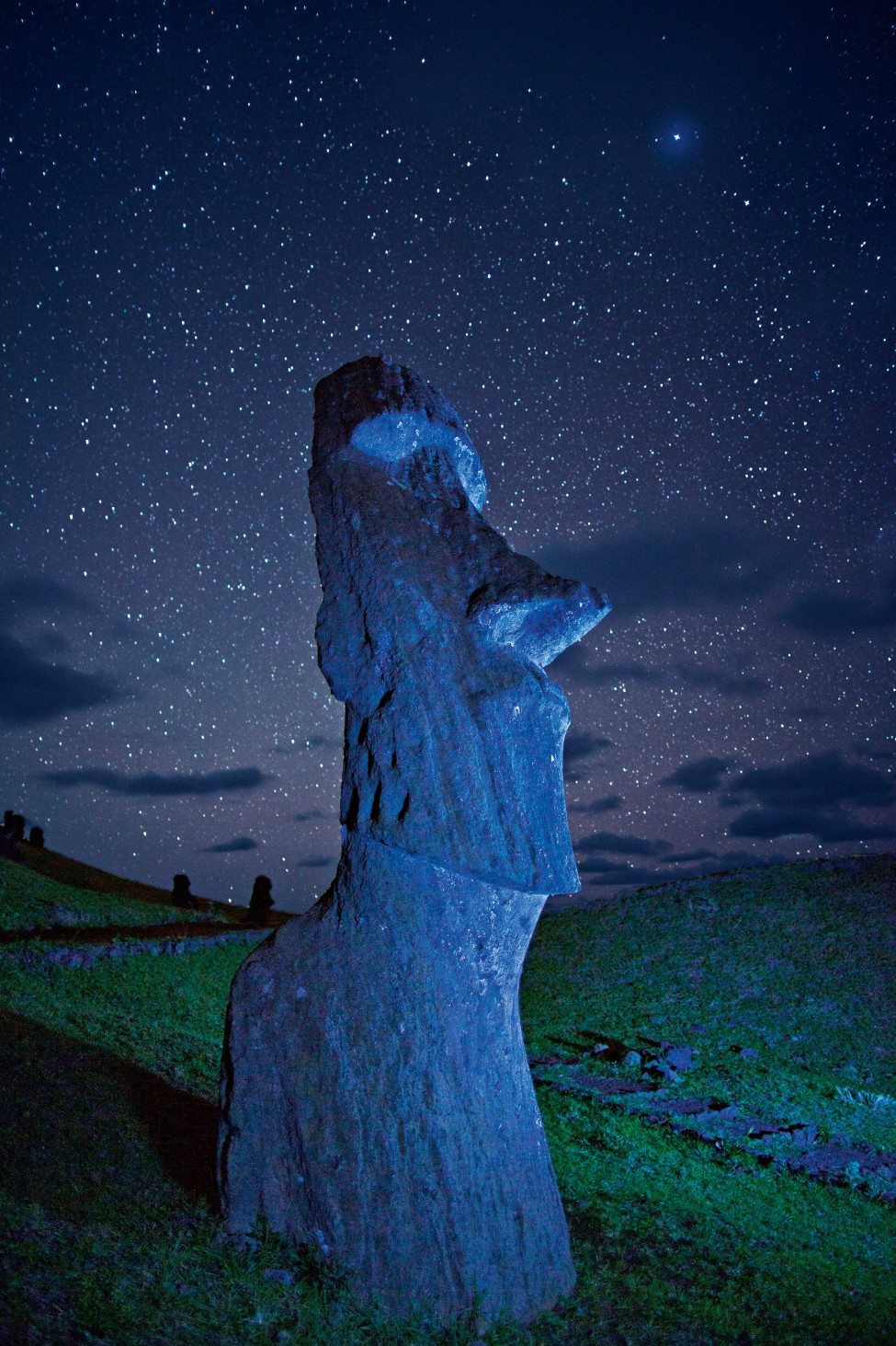 An ancient Moai statue on a hillside at night on Easter Island (Rapa Nui) in the south-eastern Pacific Ocean. The island falls within Chilean territory and its government has proposed the Easter Island Marine Park, which would protect more than 630,000 square kilometres of ocean. <br /> Photo by Randy Olson | National Geographic Creative